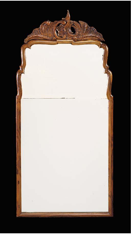A DUTCH CARVED WALNUT MIRROR, 18TH CENTURY