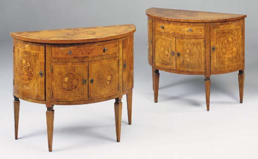 A PAIR OF ITALIAN WALNUT, TULIPWOOD CROSSBANDED AND MARQUETRY DEMI-LUNE COMMODES, LATE 19TH/EARLY 20TH CENTURY