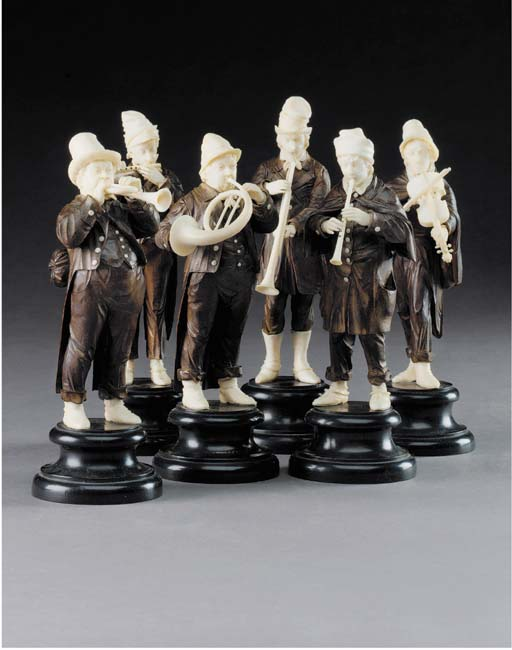 A set of six German Erbach ivory and stained wood figures of itinerant musicians, late 19th century