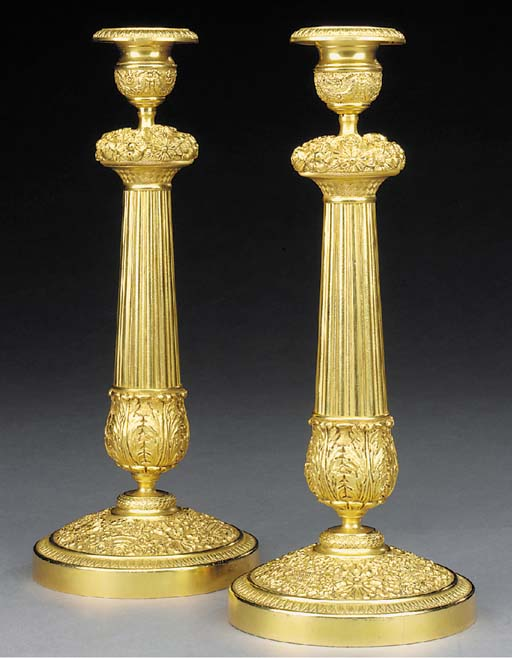 A pair of French gilt bronze candlesticks, 20th century