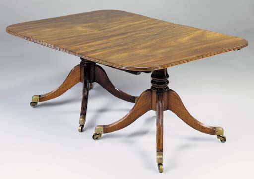 A GEORGE III MAHOGANY TWIN PEDESTAL DINING TABLE