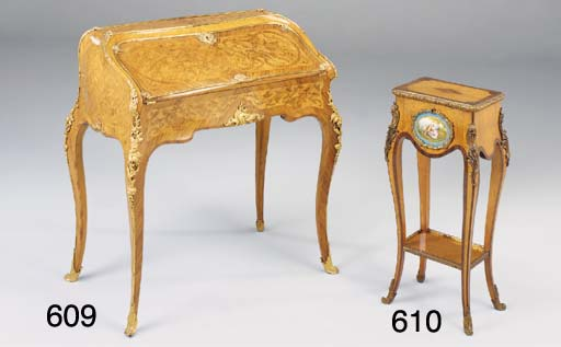 A VICTORIAN MAPLE VENEERED ROSEWOOD CROSSBANDED GILT METAL AND ORMOLU MOUNTED WORK TABLE, in the Louis XV style