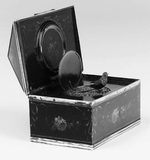 A singing bird box with watch,