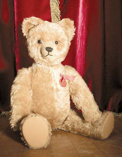 A Schuco Tricky yes/no musical teddy bear