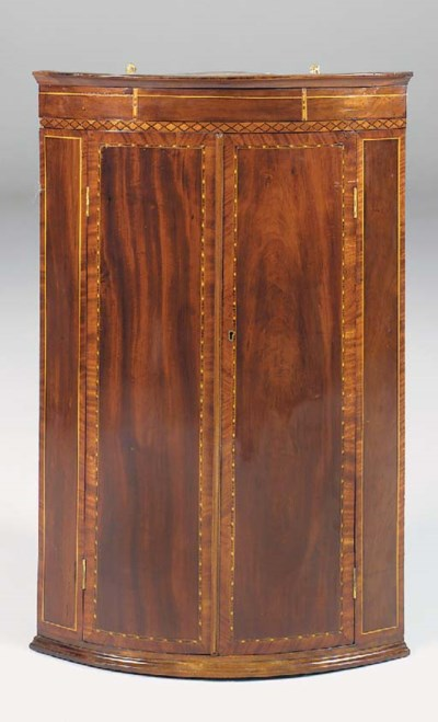 A MAHOGANY AND MARQUETRY BOWFR