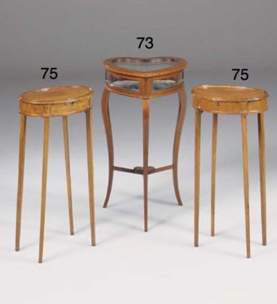 A pair of mahogany urn tables,