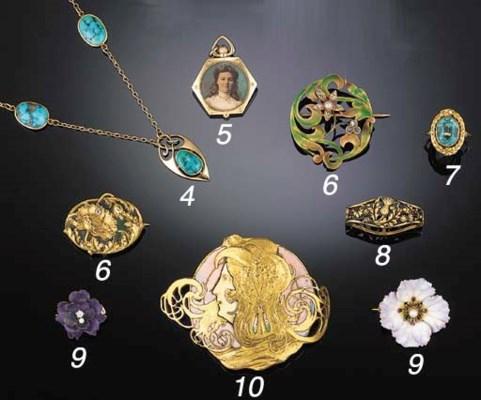 An Art Nouveau gilt and enamel