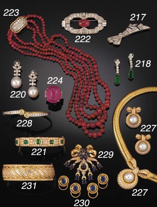 A diamond and ruby bead neckla