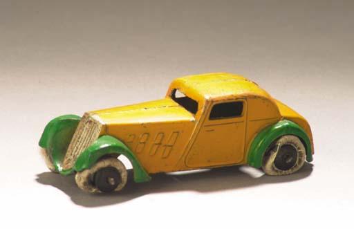A pre-war Dinky lead-cast yellow 22d Coupé Grand Sport