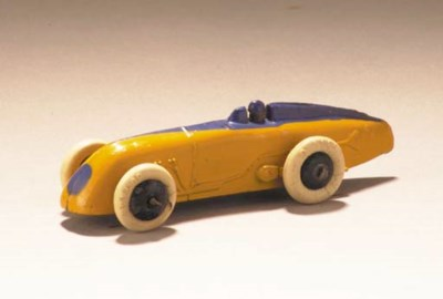 A pre-war Dinky yellow and nav