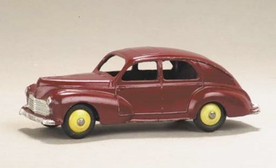 A Dinky maroon 24r Peugeot 203