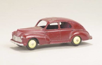 A Dinky maroon 24r Peugeot 203