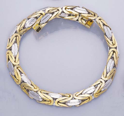 AN 18K YELLOW AND WHITE GOLD N