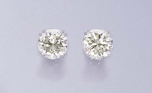 A PAIR OF CIRCULAR-CUT DIAMOND
