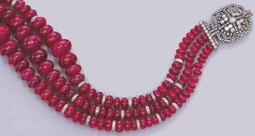 A THREE-STRAND RUBY BEAD AND D