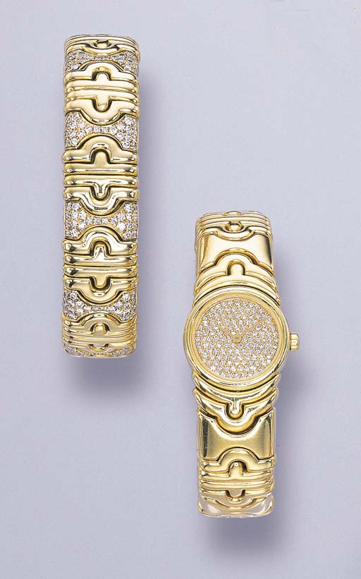 A SET OF 18K GOLD AND DIAMOND