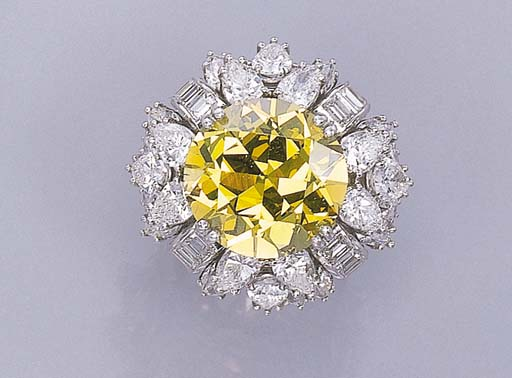 A DIAMOND AND TREATED YELLOW D