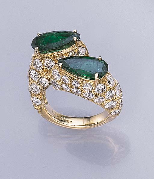 A TWIN-STONE EMERALD RING, BY