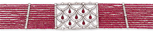 A MULTI-STRAND RUBY BEAD AND D