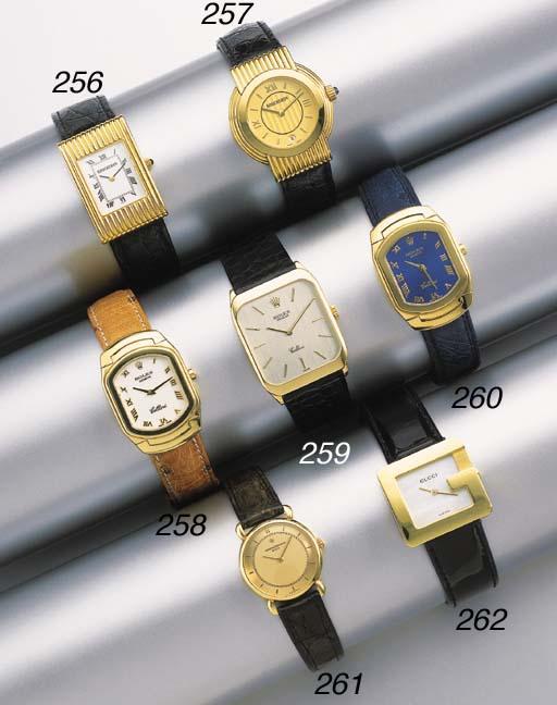 Rolex. An 18K gold rectangular