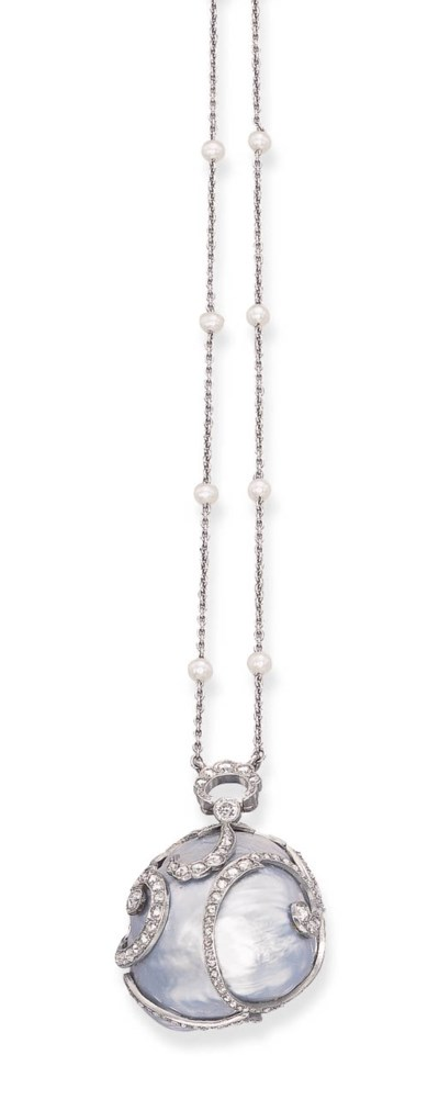A GREY-BLUE BAROQUE PEARL AND