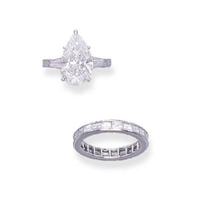 A DIAMOND RING AND A DIAMOND E