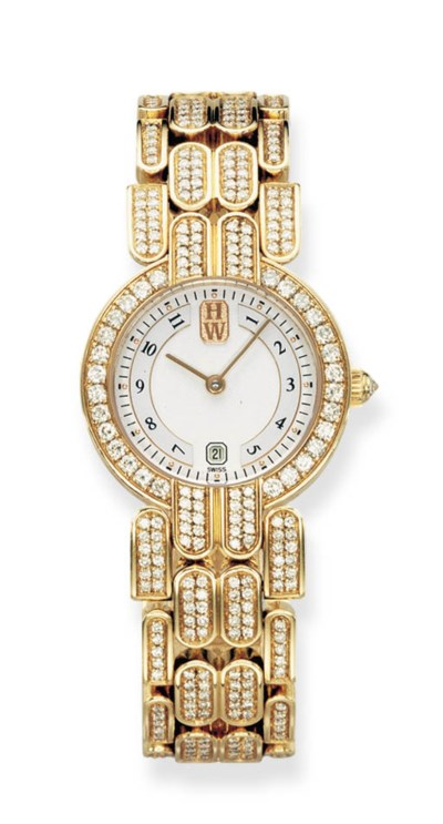 A DIAMOND AND 18K GOLD WRISTWA