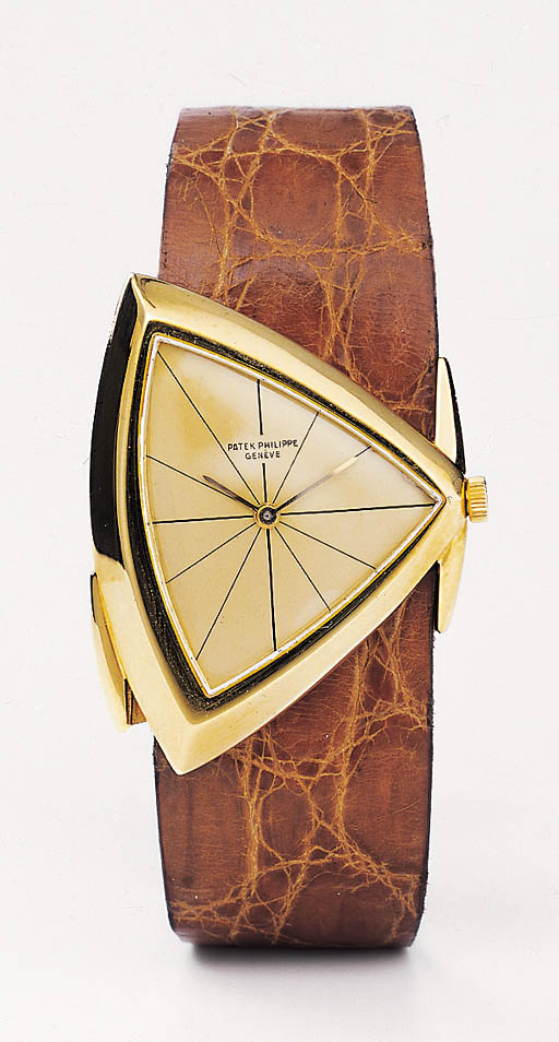 PATEK PHILIPPE, A FINE AND RARE 18K GOLD PROTOTYPE ASSYMETRICAL WRISTWATCH, NEVER MADE IN SERIES.