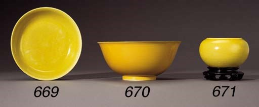 A LARGE YELLOW-ENAMELLED BOWL