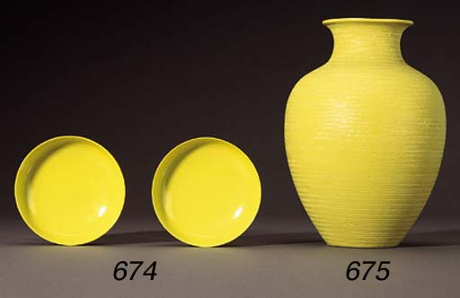 A CARVED YELLOW-ENAMELLED OVIF