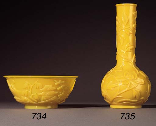 A CARVED OPAQUE YELLOW BEIJING