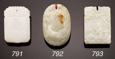 A WHITE JADE CARVED OVAL PLAQU