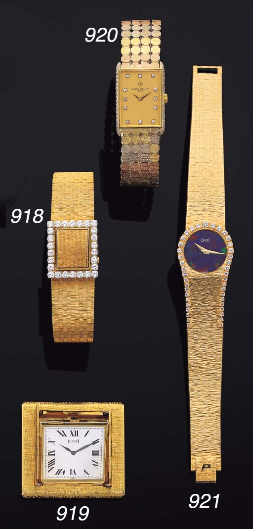 PIAGET. AN 18K GOLD TRAVELLING