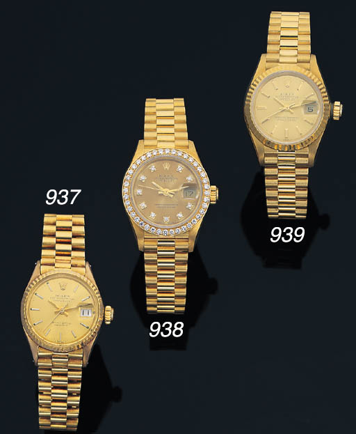 ROLEX. A LADY'S 18K GOLD SELF-