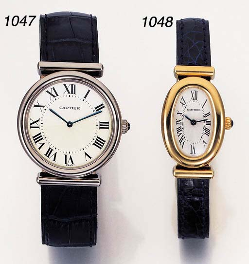 CARTIER. A LADY'S 18K GOLD OVA