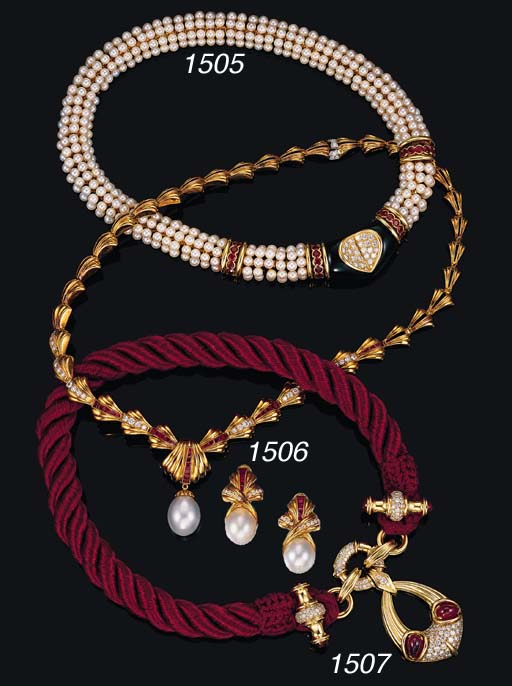 A DIAMOND, RUBY AND 18K GOLD P