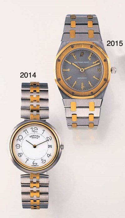 A STAINLESS STEEL AND GILT WRI