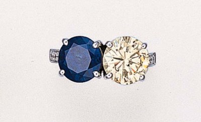 A DIAMOND AND SAPPHIRE TWO-STO