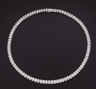 AN OVAL-CUT DIAMOND LINE NECKL