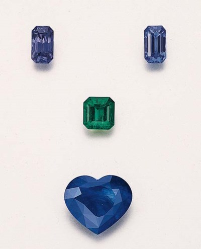 A GROUP OF FOUR UNMOUNTED GEM