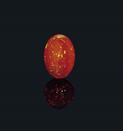 AN UNMOUNTED FIRE OPAL CABOCHO