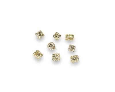 EIGHT UNMOUNTED YELLOW DIAMOND