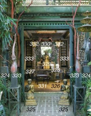 A THAI BRONZE STANDING DEITY