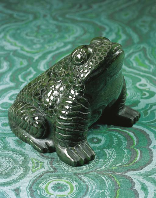 A CARVED HARDSTONE FIGURE OF A