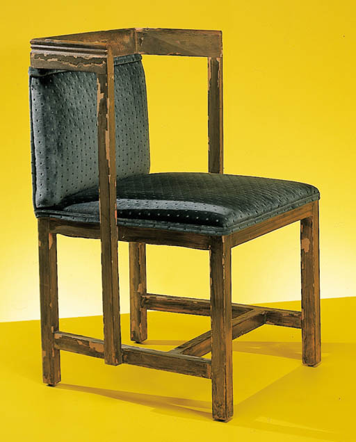 AN UPHOLSTERED AND PARCEL-GILT