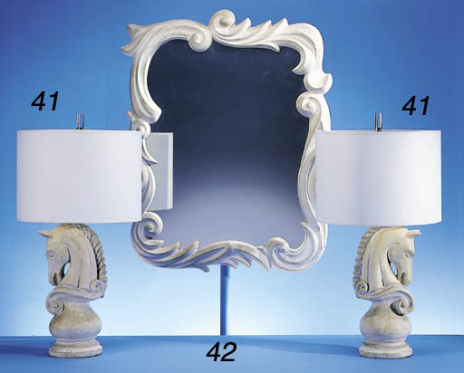 A FRENCH WHITE PLASTER MIRROR