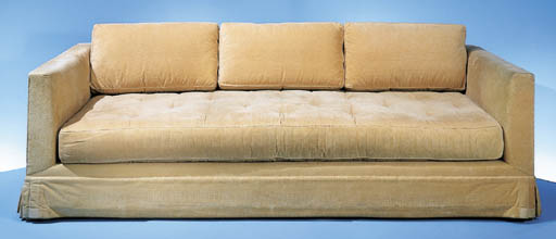 AN UPHOLSTERED SOFA