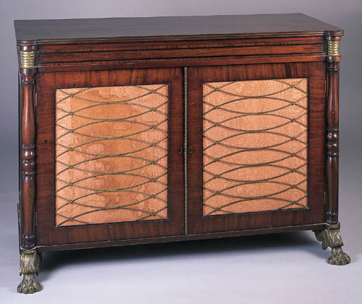 A REGENCY MAHOGANY AND BRASS M