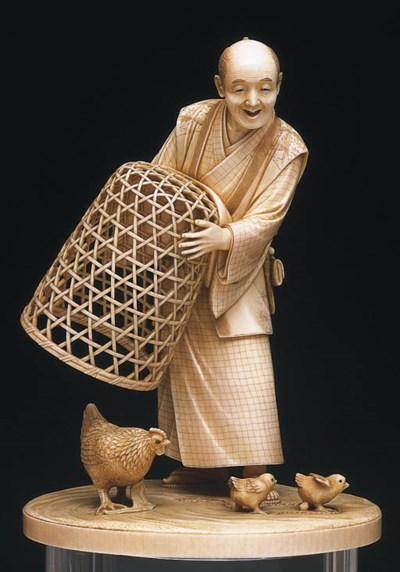 * A JAPANESE IVORY FIGURE OF A