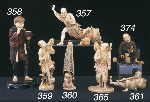 * A JAPANESE IVORY CARVING OF